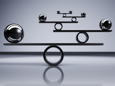 balance concept with balanced metal balls on grey background