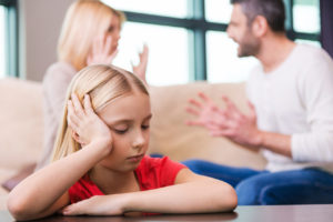 sad child listening to parents fight