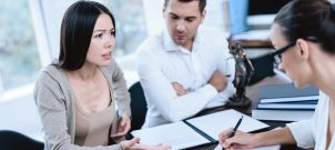 Divorce lawyer meeting with couple to start their divorce process