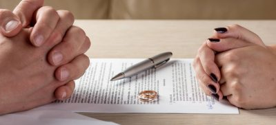 Couple sitting down for simple uncontested divorce agreement
