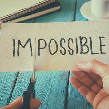 Cutting up the word impossible on a piece of paper