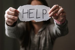 Person holding Help sign