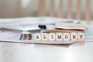 Alimony written in wooden blocks