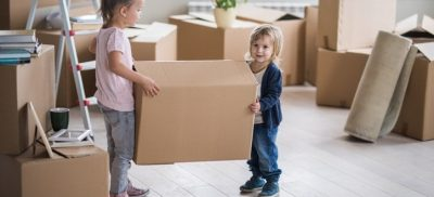 Children with moving boxes.